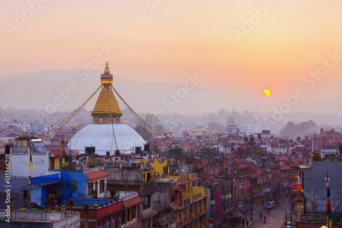 Poster Nepal Kathmandu city view on the early morning on sunrise with rising sun and famous buddhist Boudhanath Stupa temple. Tibetan traditional architecture, Nepal.
