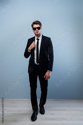 Fotografie, Obraz  Full portrait of rich stylish man in black suit and glasses