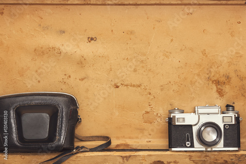 Valokuva  View of non brand vintage photographic equipment on yellow background