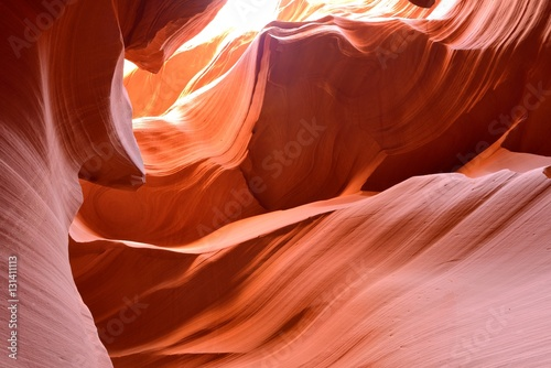 Recess Fitting Magenta Bright Red Sandstone Rocks - Sunlight shines on colorful sandstone rocks in a high desert slot canyon.