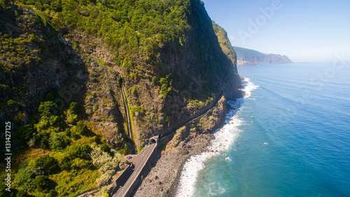 Fotografering  aerial view of waterfall and ocean in Madeira island
