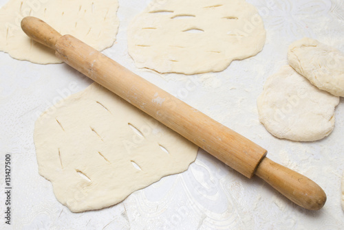 rolling dough with a rolling pin Poster
