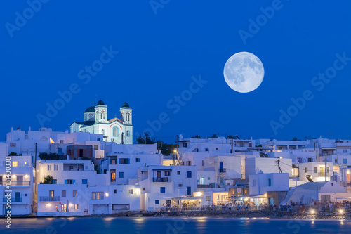 Local church of Naoussa village at Paros island in Greece against the full moon Canvas Print