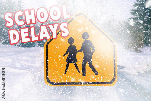 Fotografie, Obraz  Text SCHOOL DELAYS and road sign on winter background