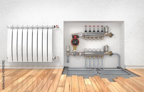 Fotografía  Heating concept. Underfloor heating with collector in the room.