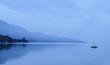 Leinwanddruck Bild - Lonely fisherman in foggy mountains, Lake Toba, Indonesia.