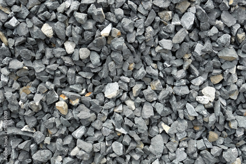 Photo stone aggregate - a stack of gray gravel, coarse loose stones with very irregular shapes, crushed and broken at a stonepit into similar sizes