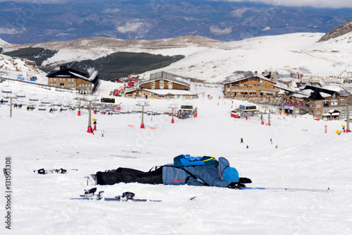 Fotobehang Antarctica man lying on cold snow after ski crash at Sierra Nevada resort in Spain with mountains