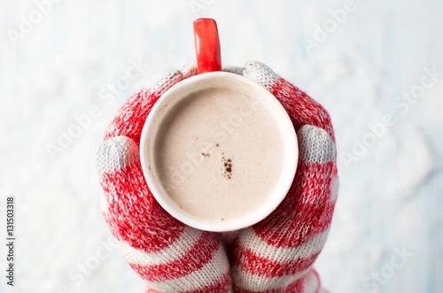 Foto op Plexiglas Chocolade female hands in gloves holding hot chocolate