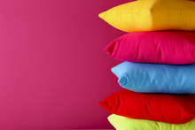 Colorful Pillows On A Pink Bac...