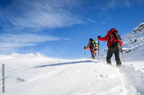 Deurstickers Alpinisme ski mountaineering in snowstorm