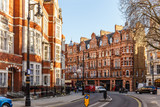 Fototapeta Londyn - Classic red brick building in Mayfair