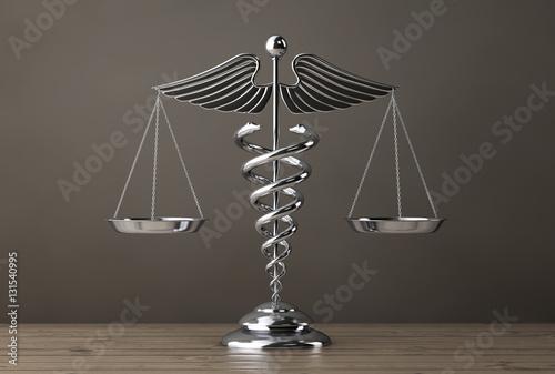 Fotografía  Silver Medical Caduceus Symbol as Scales. 3d Rendering