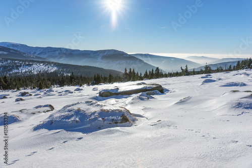 Sun shining over snow covered Giant mountains, Czech Republic Poster