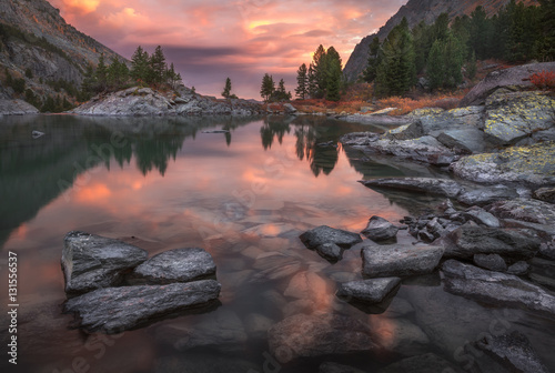 Fotobehang Cappuccino Mountain Lake Sunset Coast With Pine Forest And Rocks, Altai Mountains Highland Nature Autumn Landscape Photo