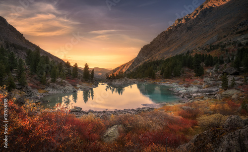 Foto op Plexiglas Natuur Pink Sky And Mirror Like Lake On Sunset With Red Color Growth On Foreground, Altai Mountains Highland Nature Autumn Landscape Photo