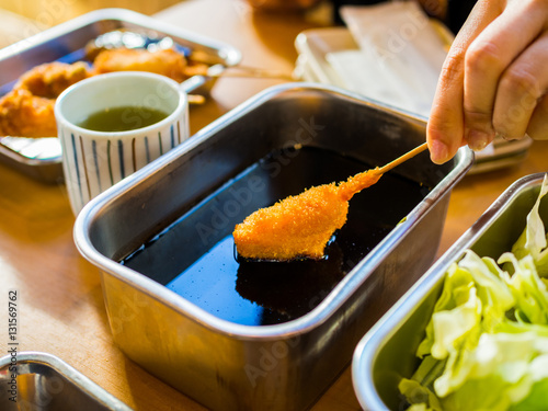 Photo  Kushikatsu, Japanese dish of deep fried skewered meat and vegeta