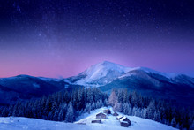 A Small Village In The Snow-covered Carpathians