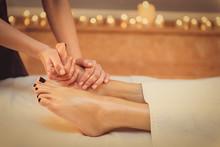 Skillful Beautician Undergoing Feet Massage