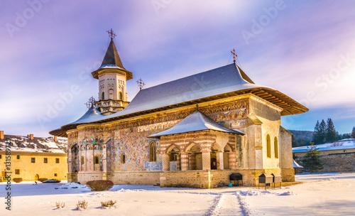 Fotografie, Obraz  Sucevita orthodox painted church monastery in winter season, Suceava town, Molda