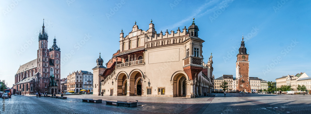 Fototapety, obrazy: Panorama of Main Market Square (Rynek) in Cracow, Poland with the Renaissance Drapers' Hall (Sukiennice), Gothic St Mary church, medieval city hall tower. The biggest medieval market square in Europe