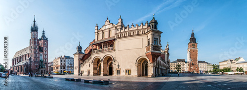 Fotobehang Krakau Panorama of Main Market Square (Rynek) in Cracow, Poland with the Renaissance Drapers' Hall (Sukiennice), Gothic St Mary church, medieval city hall tower. The biggest medieval market square in Europe