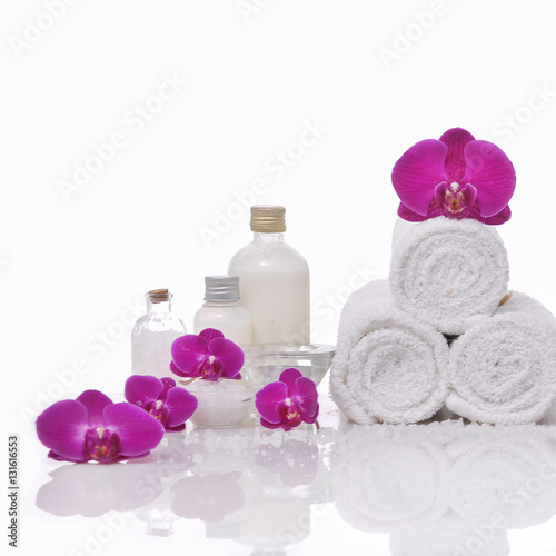 Spoed Foto op Canvas Spa Spa still life with bottle of herbal essenses with orchid,towel