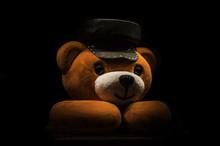 Teddy Bear In A Hat On A Black Background