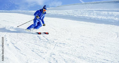 Garden Poster Winter sports Young athlete skiing in Deux Alps french mountains on sunny day
