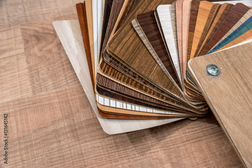 Fotografie, Obraz  Veneer packs contain samples of blackwood on desk