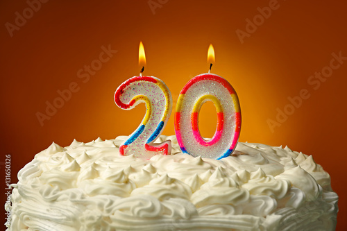 Photographie  Birthday cake with candles on color background