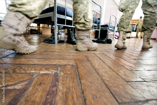soldiers in uniform in the military barracks Canvas Print