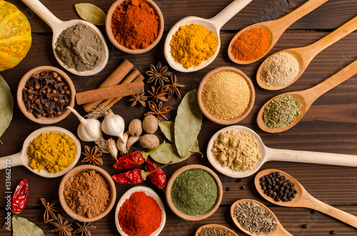 Colorful spices, dried herbs, cuisine, top view Canvas Print