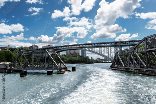 Fotografie, Tablou  Swing bridge on the Hudson River opening to let a boat pass through