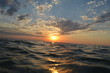 Stunning sunset on the waves sea with a beautiful bright blue sky with clouds or Caspian sea on the sunset