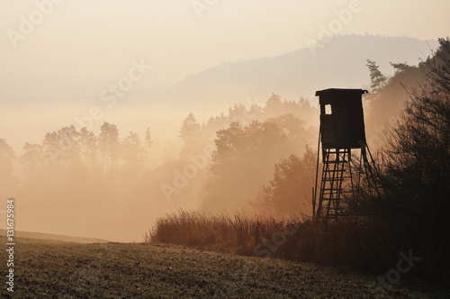 Papiers peints Chasse Autumn sunrise atmosphere with hunting high stand in Czech Republic