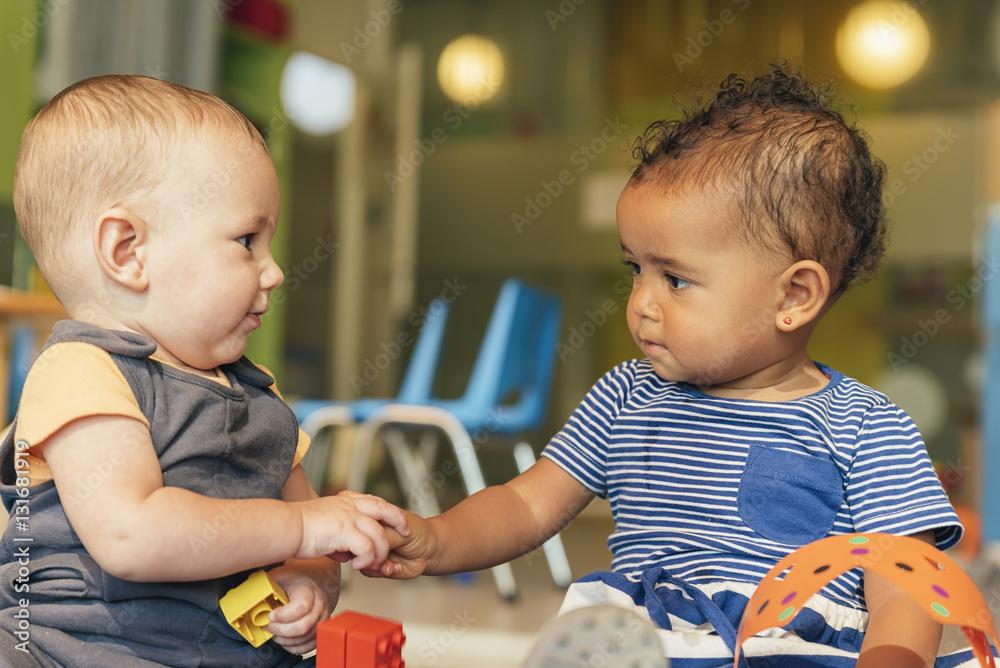Fototapety, obrazy: Babys playing together.