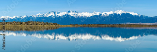 Sangre de Cristo Mountains - Panoramic view of Snow-capped Sangre de Cristo Mountains, reflecting in San Luis Lake. Colorado, USA.