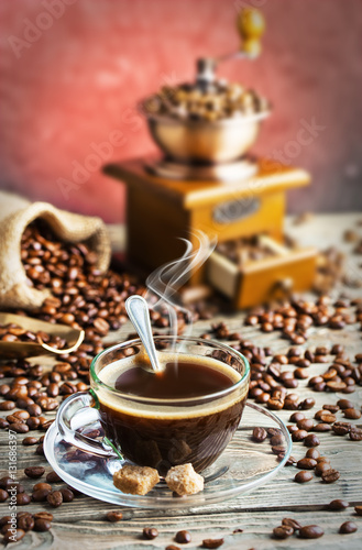 Fototapety, obrazy: Black coffee in a cup on old background