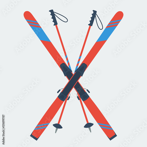 Photo Pair of red skis and ski poles