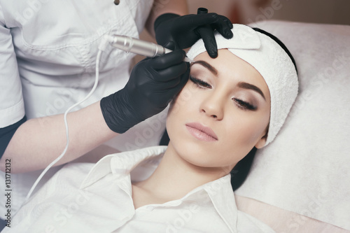 Permanent makeup. Tattooing of eyebrows Canvas Print