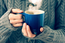 Blue Cup In Woman's Hands