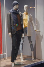 Mannequins In Warm Clothes On Display. Fashion
