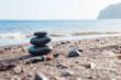 Stones pyramid on the sea coast