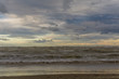 sea and beach with clouds. Rough sea