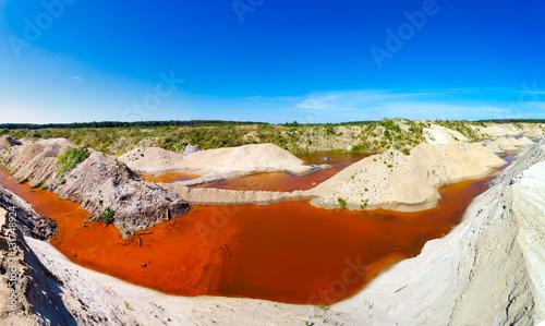 Fototapeta sand quarry filled with water saturated minerals obraz na płótnie