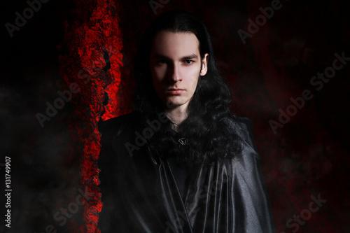 Valokuvatapetti beautiful vampire man in the black coat