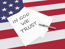 American Slogan: Note In God We Trust With Pen On US Flag Stars And Stripes, 3d Illustration