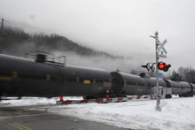 A Train Of Tanker Cars Rolls T...
