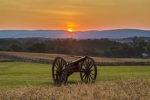 Sun Rising Behind Artillery Near A Wheat Field At Antietam Natio